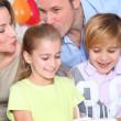 Family celebrating child's birthday — Stock Photo