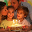 Family celebrating child's birthday — Stockfoto #6698533