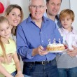 Family celebrating grandfather's birthday — Stock Photo #6698535