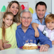 Family celebrating grandfather's birthday — Stok Fotoğraf #6698537