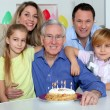 Family celebrating grandfather's birthday — Stock Photo #6698537