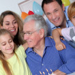 Family celebrating grandfather's birthday — Stock Photo