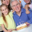 Family celebrating grandfather's birthday — Stock Photo