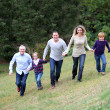 Family having fun running in park — Stock Photo #6698706