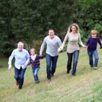 Family having fun running in park — Stock Photo