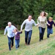 Family having fun running in park — Stock Photo #6698711