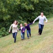 Family having fun running in park — Stock Photo #6698719