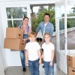 Family of 4 moving in new home — Stock Photo