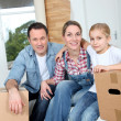Happy family moving in new house — Stock Photo