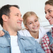 Portrait of happy couple with little girl — Stock Photo