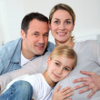 Portrait of family expecting new baby to come — Stock Photo