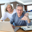 Senior couple making secured payment on internet — Stock Photo #6699293