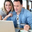 Couple doing online shopping wih laptop computer — Stock Photo #6699377