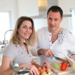 Couple in home kitchen preparing meal — Foto Stock