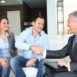 Couple shaking hand to real-estate agent - Stock Photo