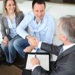 Couple shaking hand to real-estate agent — Stock Photo #6699445