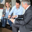 Couple with real-estate agent signing home investment contract - Stock fotografie