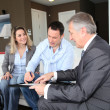 Couple with real-estate agent signing home investment contract — Foto Stock