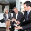 Senior couple signing financial contract for property purchase — стоковое фото #6699478
