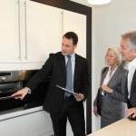 Senior couple choosing new kitchen — Stock Photo