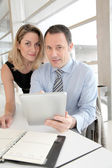 Business working on electronic tablet — Stock Photo