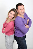 Happy couple standing on white background — Stock Photo