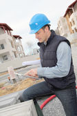 Supervisor using electronic tab on construction site — Stock Photo