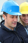 Closeup of architects with security helmets — Stock Photo