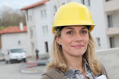 Woman engineer with security helmet standing on construction site — Stock Photo