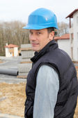 Site supervisor with security helmet standing on construction site — Stock Photo
