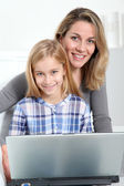Mother and daughter surfing on internet — Stock Photo