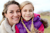 Portrait of smiling mother and daughter — Stock Photo