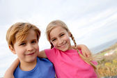 Brother and sister portrait in summer time — Stock Photo