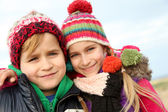 Brother and sister portrait in winter time — Stock Photo