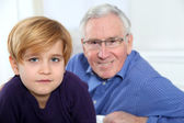 Portrait of little blond boy with grandfather — Stock Photo