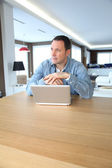 Adult man surfing on internet at home — ストック写真