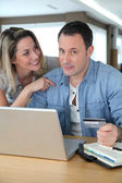 Couple doing online shopping wih laptop computer — Stock Photo