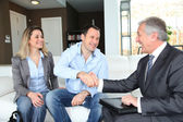 Couple shaking hand to real-estate agent — Photo