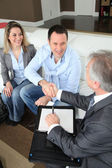 Couple shaking hand to real-estate agent — Stock Photo