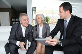 Senior couple discussing financial plan with consultant — Stock Photo