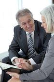 Senior man meeting senior businesswoman — Stock Photo