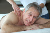 Senior man having a massage — Stock Photo