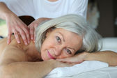 Senior woman having a massage — Stock Photo