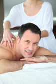 Handsome man having a massage — Stock Photo