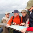 Group of looking at map on a hiking day — 图库照片