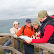 Stock Photo: Group of looking at map on a hiking day