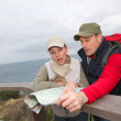 Couple looking at map on a hiking day — Stock Photo #6700087