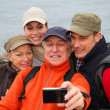 Stock Photo: Group of hikers taking picture of themselves