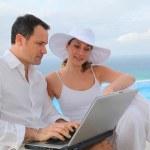 Couple using laptop computer — Stock Photo #6700259