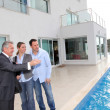 Couple visiting luxury villa with real-estate agent — Stock Photo